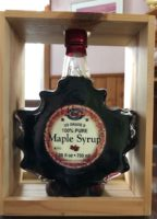 LARGE BOTTLE OF MAPLE SYRUP IN LEAF SHAPED BOTTLE